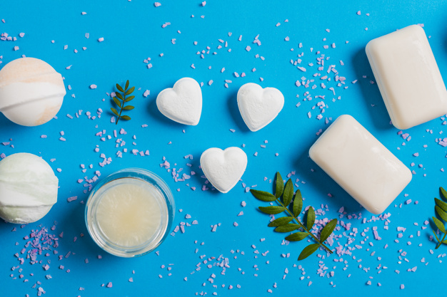 Soap pills of heart and rectangle shapes in blue background